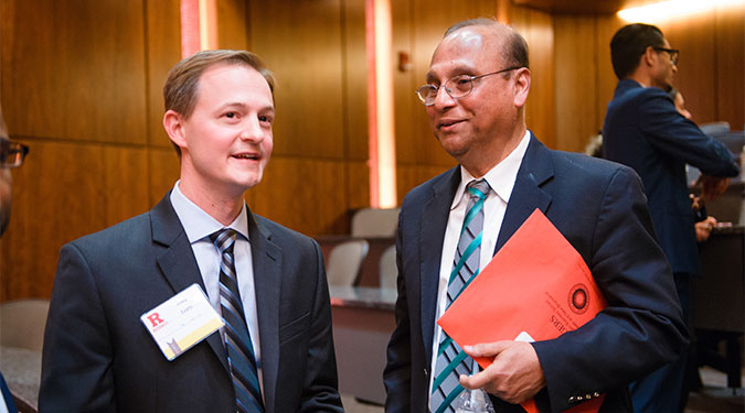 Rutgers MBA student Andrew Evans with Professor Mahmud Hassan at the competition.