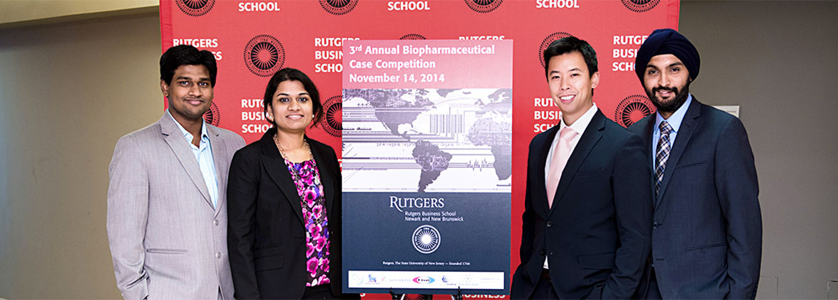 Members of the Rutgers Biopharmaceutical Case Competition team pose in front of the competition banner