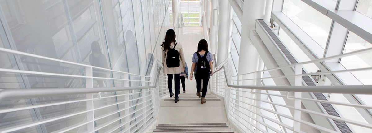 Students walking down stairs