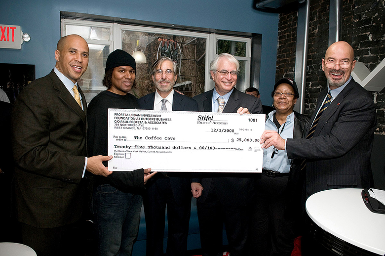 Center members, Cory Booker, and local owners of The Coffee Cave holding a check from Paul Profeta Urban Investment Foundation for $25,000