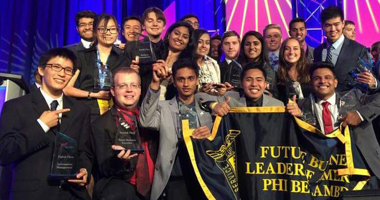 Members of Future Leaders of America-Phi Beta Lambda celebrate their awards at a national conference.