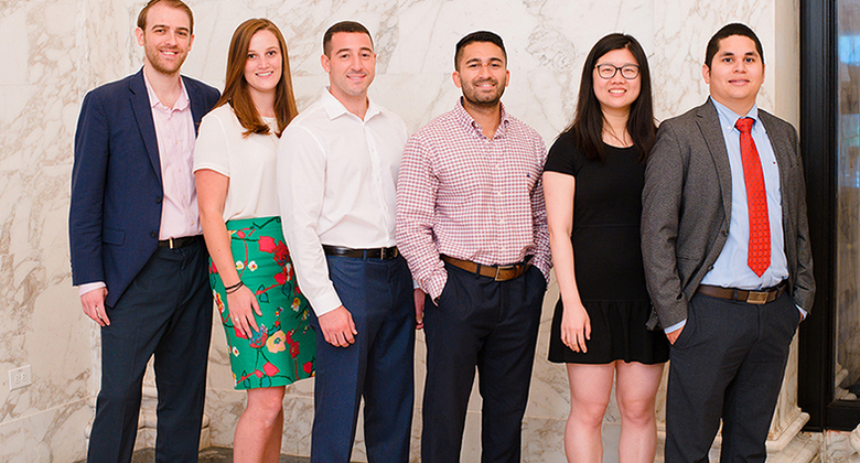Current students in the MBA in Professional Accounting program, including Isobel Menard (second from left) and Tom Giordano (third from left).
