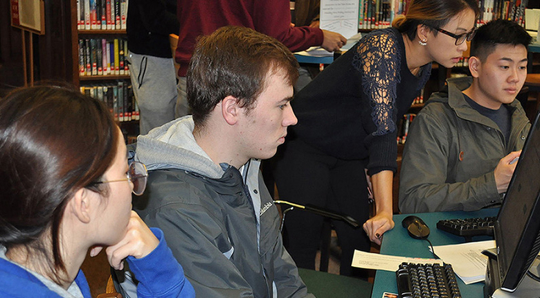 Rutgers Business School accounting students assisting New Brunswick residents with income tax filings.
