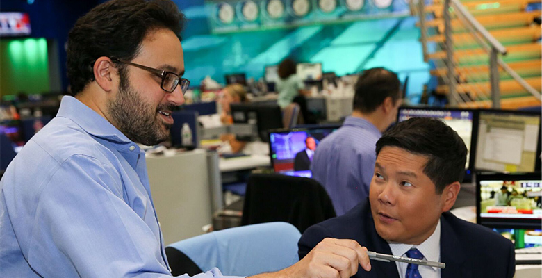 David Spiegel (left) speaks with CNBC markets reporter Dominic Chu. Photo credit: Adam Jeffrey, CNBC senior photo editor.