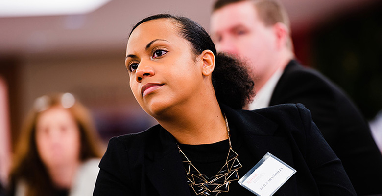 Keila Aramboles listen in the audience.