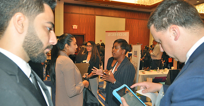 Rutgers Business School students navigated among 93 employers set up inside the Hyatt Regency Hotel in New Brunswick.