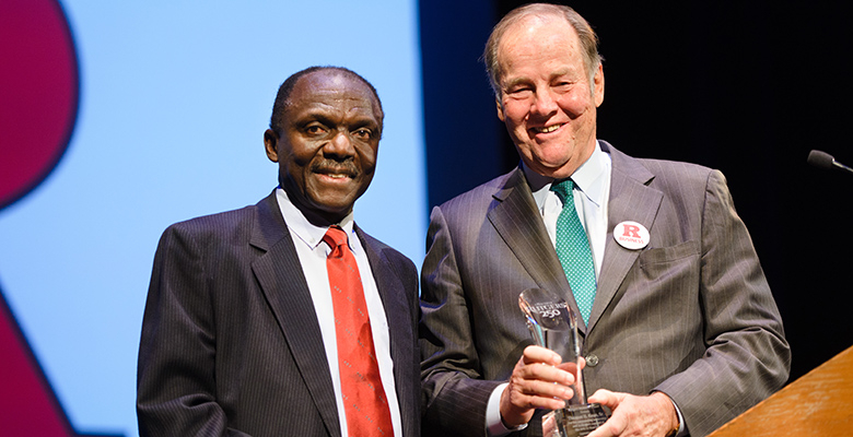 "Former Gov. Thomas Kean receives a ""hero"" award from Rutgers Business School Executive Vice Dean Yaw Mensah."