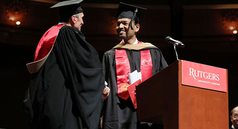 Student Shweytank Agrawal introduces convocation speaker William Federici.