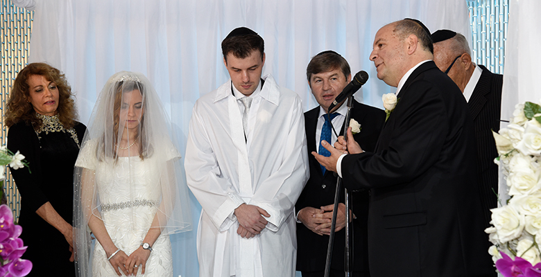 Mitchell Novitsky volunteers as a rabbi, performing a marriage.