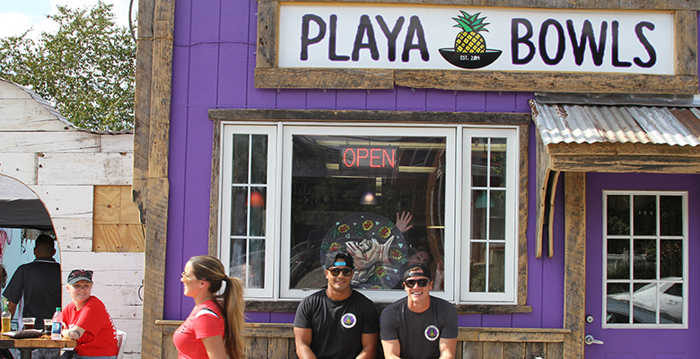 Desi Saran and Robert Guiliani at 53 Mine Street in New Brunswick during the grand opening celebration of the newest Playa Bowls location.