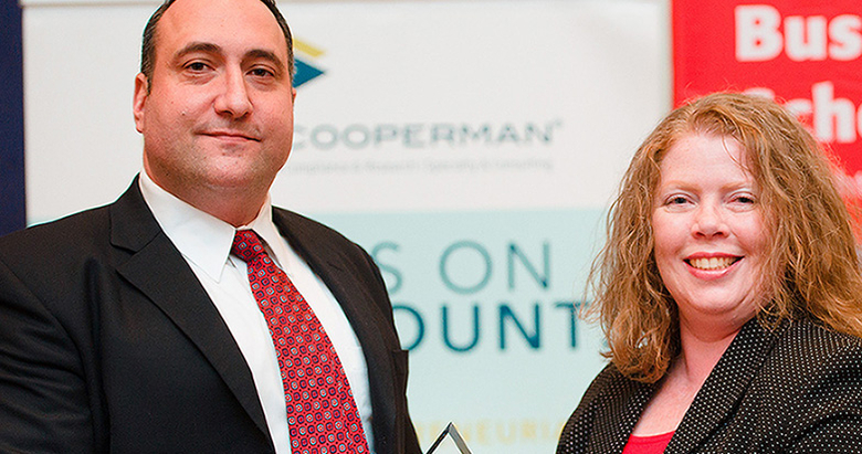 Veteran Eric Kropiwnicki, who completed the Rutgers Business School Executive Education Mini-MBA: Business Management for Military and Veterans, is honored for his leadership by Margaret O'Donnell, manager of Military and Veteran Engagement Programs at Rutgers Business School.