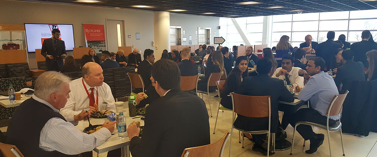 Members of the center together eating lunch at a center event