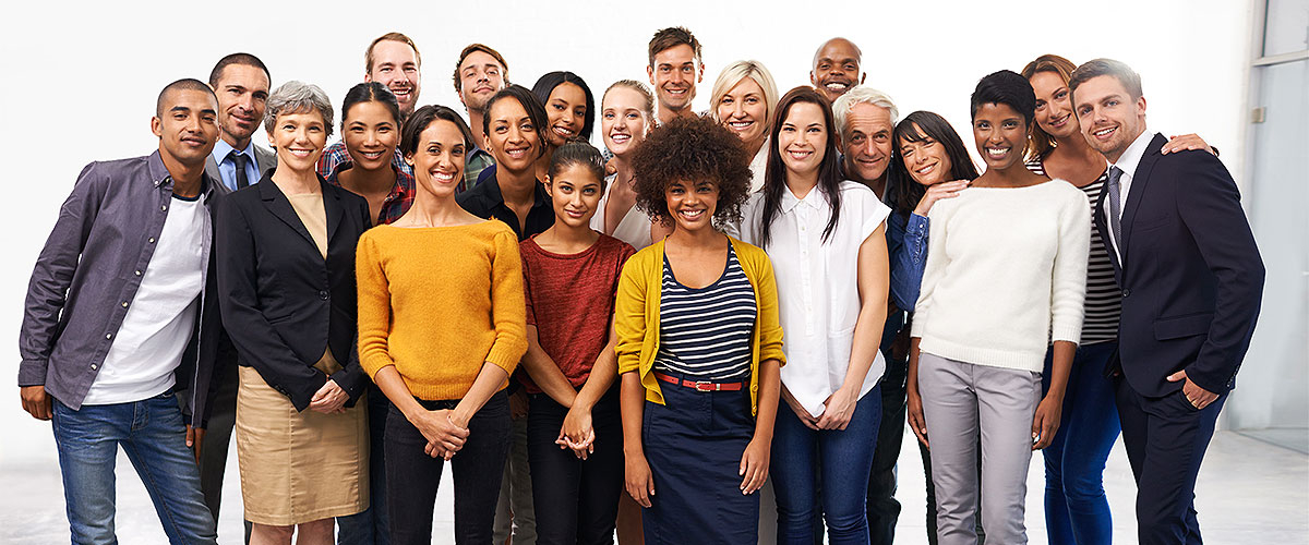 A group of people from various backgrounds posing together for a photo